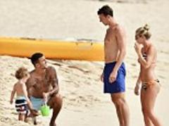 Fancy seeing you here: Man Utd star Jonny Evans bumps into Tottenham's Kyle Walker on a Barbados beach