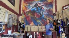 how did outpost music get tom noll's giant bob marley painting?
